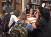Middle School Studentsa at Table in Library