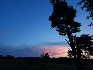 After the June 21 Sunset  with moon in sky at left