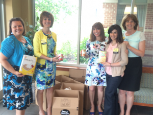 Riderwood retirement community and Let's Move partnered on a project to support Move For Hunger.  Pictured from left to right during a sales event at Riderwood on May 13 are Kimberly Schoeberlein, (Personal Moving Consultant, Riderwood), Kim McMahon, (Co-Founder, Let's Move), Diane Thometz, (Personal Moving Consultant, Riderwood), Georgia Korologos, (Office Manager, Let's Move) and Yvonne Quade, (Account Manager, Let's Move).