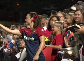 Spirit player takes selfie with fans after aug 1 game against houston dash