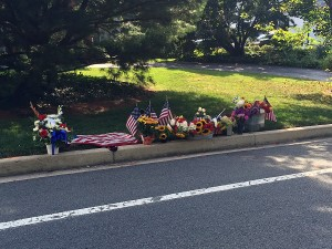 A memorial is growing along Massachusetts Avenue where a bicyclist was killed on Aug. 28.