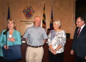 "Jim Clifford (second from left) and his wife, Carol, get a laugh from Montgomery County Councilmember Nancy Floreen's definition of ""old"" as the Council on Sept. 29 honored the lawyer from Poolesville for becoming the oldest to complete the Open Water Triple Crown of swimming. Mr. Clifford, at age 63, recently finished the last leg of the feat, which includes swimming 21 miles across the English Channel, 20.2 miles across the Catalina Channel and 28.5 miles around Manhattan Island. Councilmember Sidney Katz also joined in congratulating Mr. Clifford."