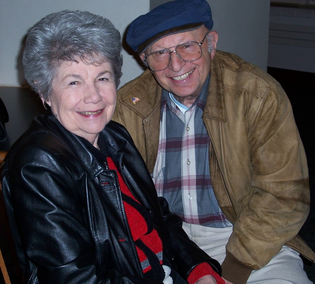 """In this 2006 photo, Harry and Jeanette waited in a University of Maryland theater lobby to see grandson Mark perform with Cornell University's improv comedy team. Harry felt at home on campus, where he took courses and volunteered for 15 years post-retirement. (Also, UMD was Jeanette's workplace for 20 years and granddaughter Sandy's alma mater.) Never mind that the cost of textbooks maddened Harry, he thoroughly enjoyed mingling with his young classmates, as he revealed in an earlier post on this blog: """"The value of learning and journaling, according to this self-educated man"""""""