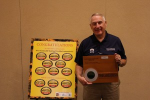 Poolesville Commissioner Jerry Klobukowski with the Sustainable Maryland Certified award at the MML Conference.