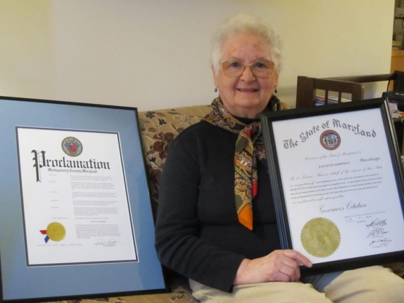 Paulette Goodman, a resident of Riderwood retirement community, is pictured in 2013 with local and state citations for her then-thirty years of service to the Metro DC Chapter of PFLAG.