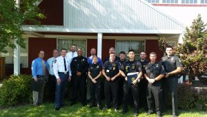 City of Gaithersburg Police Chief Mark Sroka & Montgomery County Police 6th District Gaithersburg  Commander Dinesh Patil with the Montgomery County Police 6th District Gaithersburg awardees at the Gaithersburg-Germantown Chamber of Commerce 21st Annual Public Safety Awards Breakfast on July 8, 2016.  (photo credit: Laura Rowles, GGCC)