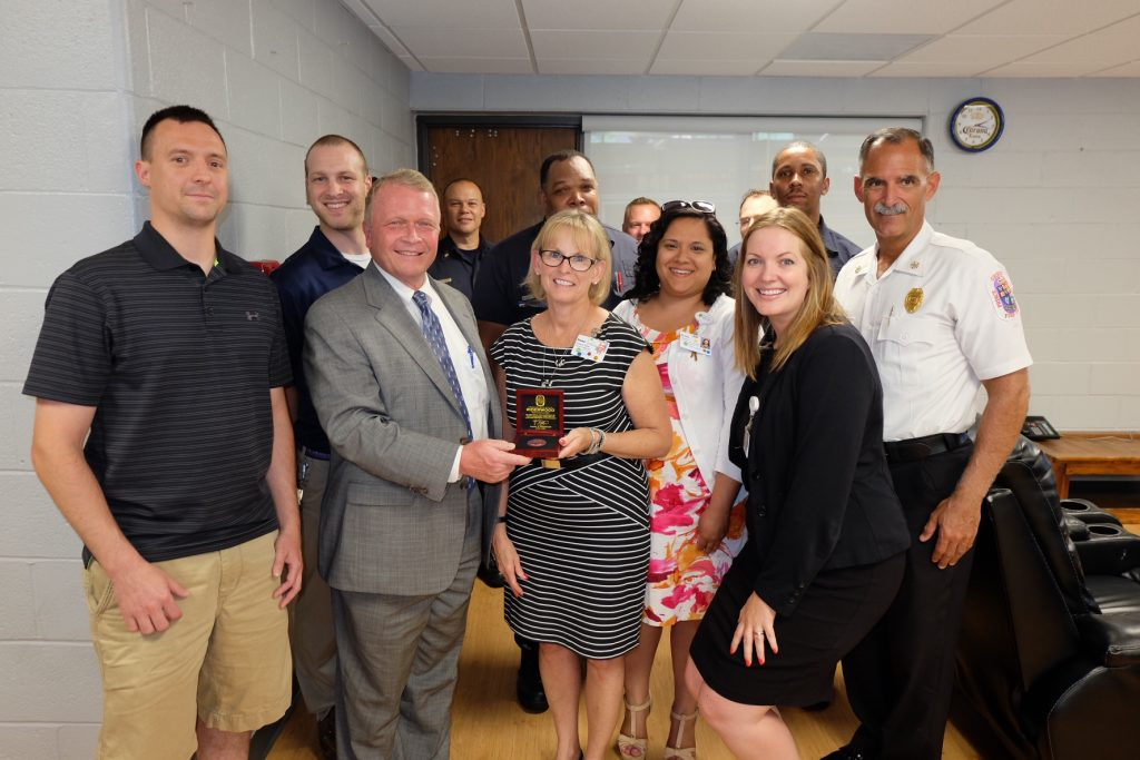 "SAYING THANK YOU: Riderwood employees and three of its vendors partnered to renovate the kitchen and lounge area at Calverton Fire/EMS Station 841 on Powder Mill Road.  A celebratory ""reveal"" was held at the station on July 8 with those involved in the project."