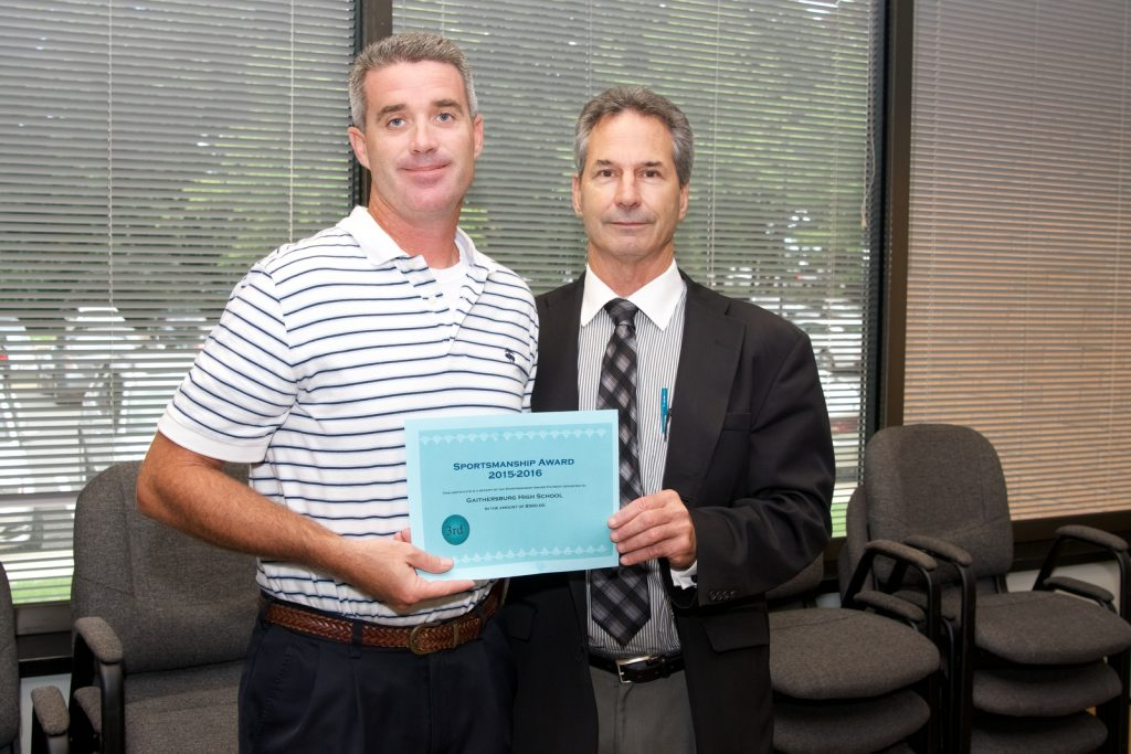 MCPS Sportsmanship Award. Awarded by Duke Beattie, MCPS Director of Systemwide Athletics. Award recipients were the tops in all categories as judge by observers over the 2015-16 Season. Awards were given at the annual meeting between the 25 High School Athletic Directors and District representatives of the Montgomery County Police Department (MCPD). Third Place - Gaithersburg HS, accepting is Jason Woodward, Athletic Director.