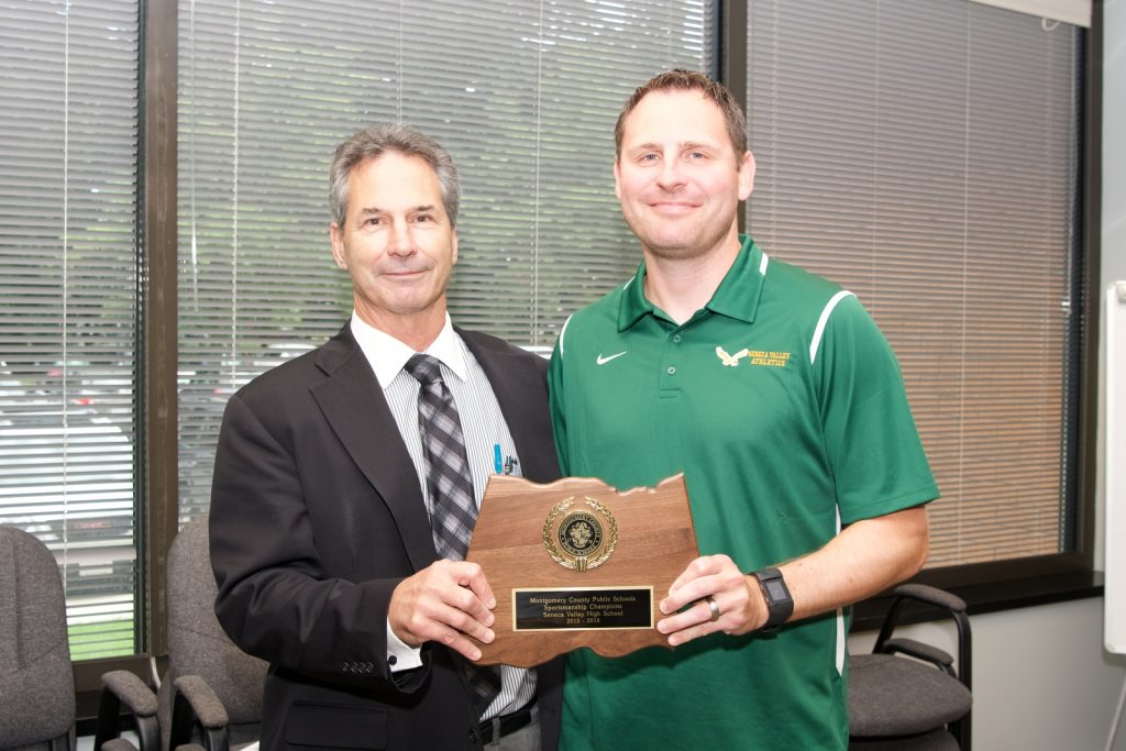 MCPS Sportsmanship Award. Awarded by Duke Beattie, MCPS Director of Systemwide Athletics. Award recipients were the tops in all categories as judge by observers over the 2015-16 Season. Awards were given at the annual meeting between the 25 High School Athletic Directors and District representatives of the Montgomery County Police Department (MCPD). First Place - Seneca Valley HS, accepting is Jesse Irvin, Athletic Director.