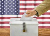 ballot box man casting vote iStock_000077854763_sized