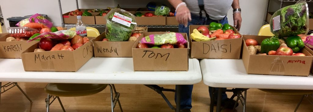 Participants choose and tag the boxes they want. Volunteers then bag the food just like at the grocery store.