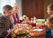 family-at-thanksgiving-dinner-istock-485470786