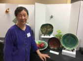 Won Yin, a resident of Riderwood, with her submissions in the 2016 Art of Ceramics exhibition