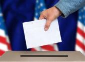 Hand casting ballot in ballot box