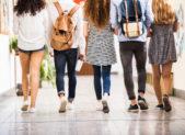 Teens in school hall iStock-824257318 1500x999