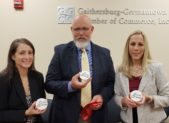 "Three Gaithersburg business owners - Kari Primozic, Courageous Living.; Ron David, ICE Firearms & Defensive Training; and Sonja Der, Bridge Performance Coaching - celebrate their new business partnership called ""C.A.S.E. Training"". C.A.S.E.  stands for Confident, Aware, Safe and Empowered. All three businesses are members of the Gaithersburg-Germantown Chamber. September 27, 2018 marks the beginning of their journey together after the official document signing commemorating their new partnership.  (photo credit: Laura Rowles, Director of Marketing, Gaithersburg-Germantown Chamber.)"