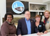 Hillside Senior Apartments offers 1- & 2-bedroom options to residents 62+; in a resort-style senior living setting. Pictured are Gaithersburg-Germantown Chamber Board Members Colette Releford, Barbara Crews, & Ellen Lambert with City of Gaithersburg Mayor Jud Ashman in Hillside's cybercafe & lounge.   (photo credit: Laura Rowles, Director of Marketing, Gaithersburg-Germantown Chamber.)