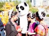 Indian women and Chinese panda at WOM photo by Ken Stanek