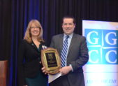 (l:r) Laura Volovski, Corporate Philanthropy & Engagement Manager at Adventist HealthCare, presents David McCormick-Goodhart, Financial Advisor, Savant Capital Management with the Gaithersburg-Germantown Chamber's 6th Annual Young Professional of the Year Award at the Chamber's Annual Celebration Dinner on December 6, 2018.  (Photo Credit: John Keith Photography)