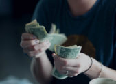 Feature person holding money
