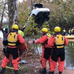 Rescue Workers Retrieve Submerged Car From Seneca Creek