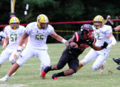 Quince Orchard defeats Damascus 21 to 7.  Bryan Bresee defends against QO's Marquez Cooper