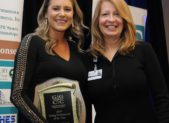 (l:r) Stephanie Evans of the Evans Legacy Group at RE/MAX Realty Group is presented the 7th annual Young Professional of the Year award by Laura Volovski, Adventist HealthCare at the Gaithersburg-Germantown Chamber Platinum Gala on December 5, 2019 (Photo Credit: John Keith Photography)
