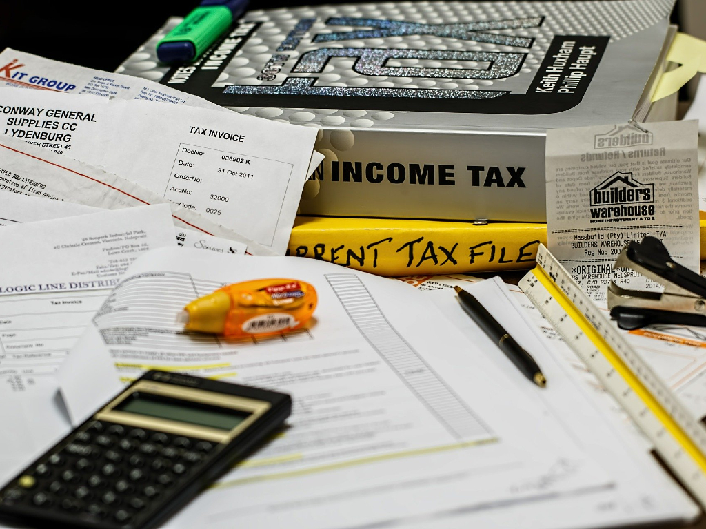 photo of calculator and income tax forms