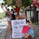 Photos: Peaceful Protesters Hold Black Lives Matter Signs in Olney