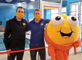(l:r) Jake Atchoo, manager; Zachary Healy, general manager; and Goldfish celebrate the grand opening of their new business – Goldfish Swim School in the Kentlands Gaithersburg. They opened the doors to the state-of-the-art aquatic facility on Friday, January 29, 2021. They are ready to welcome children ages 4 months and up. Dive in. (photo credit: Laura Rowles, GGCC Director of Marketing)