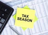 feature tax season sticker-with-text-tax-season-lying-on-the-financial-tables-calculator-picture-id1271283499