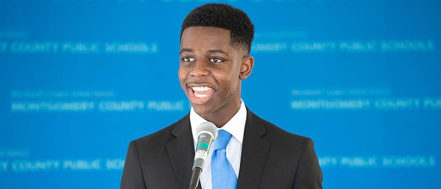 Nick Asante campaigning for the school board