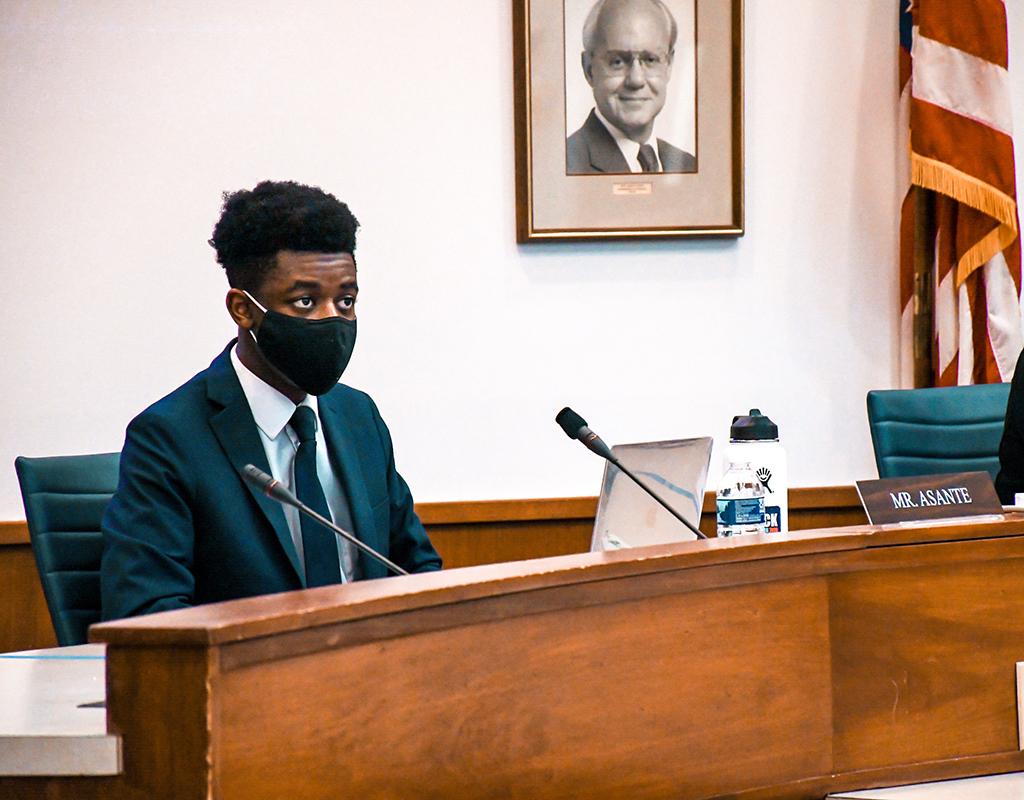 Nick Asante at school board meeting