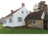2.The log slave kitchen/cabin (right), the white Riley House (center) and the modern Josiah Henson Museum and welcome center (far left).