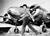feature Amelia Earhart and Elecktra plane