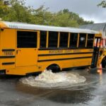 School Bus Gets Stuck in 'Sinkhole', Several Students Removed With No Injuries